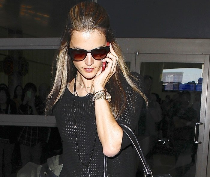 Alessandra Ambrosio wears her hair half-up half-down as she arrives at Los Angeles International Airport