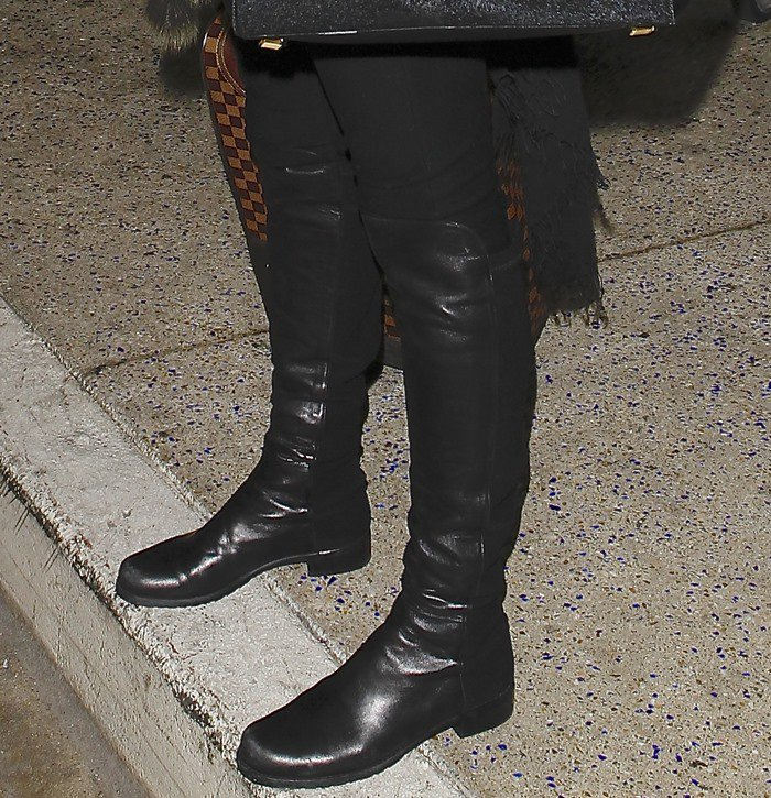 Alessandra Ambrosio's sleek leather Stuart Weitzman 5050 over-the-knee boots are one of fall's top must-haves