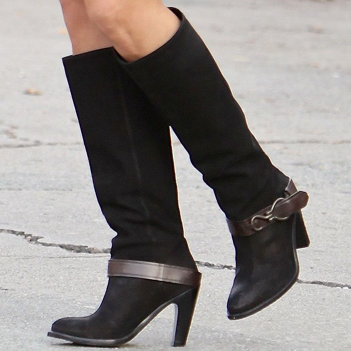 Cara Santana wears a pair of knee-high Cole Haan boots on her feet