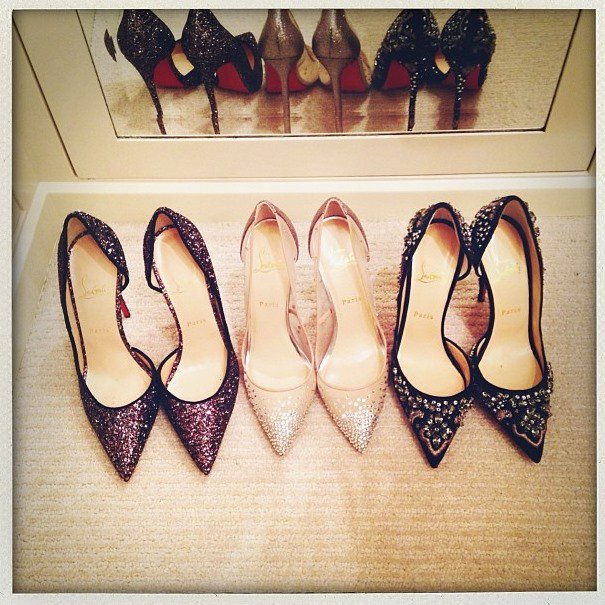 "Before attending a gala on Saturday in Los Angeles, Rosie Huntington-Whiteley tweeted this picture with the caption ""Which ones for tonight?? @louboutinworld #PartyFeet"""