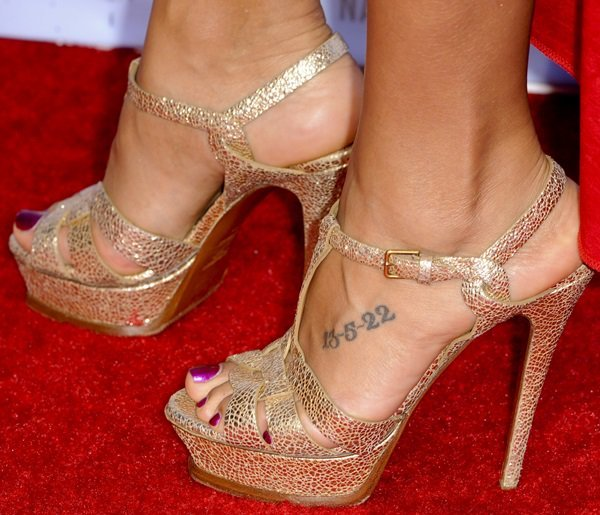 Dania Ramirez has the numbers '13-5-22' inked on top of her left foot