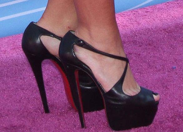 Demi Lovato shows off her feet in blackExagona stripper heels