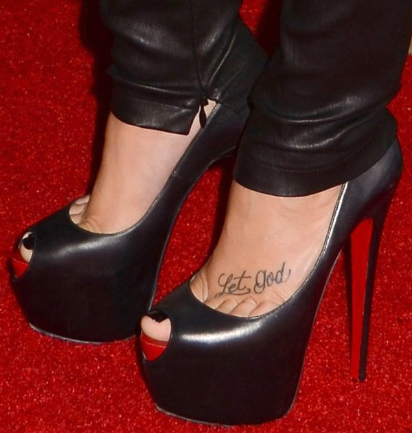 "Demi Lovato showing off her ""Let God"" foot tattoo"
