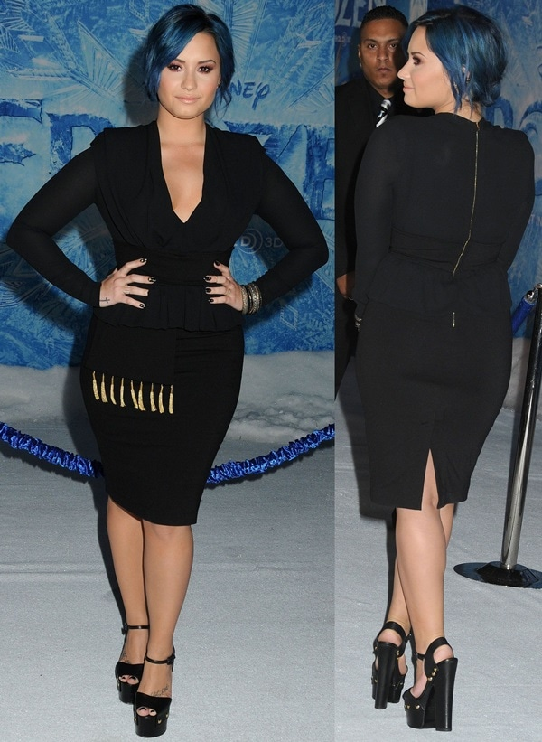 Demi Lovato shows off her cleavage in a black dress from Altuzarra