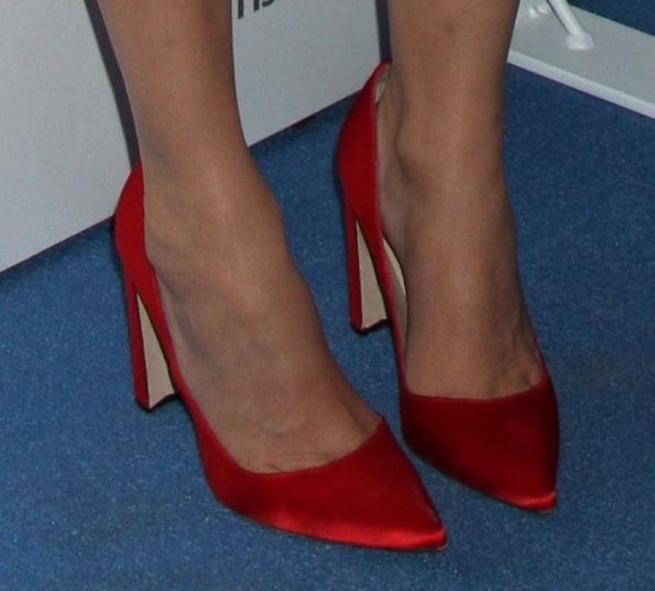 Diane Kruger wearing red satin pumps