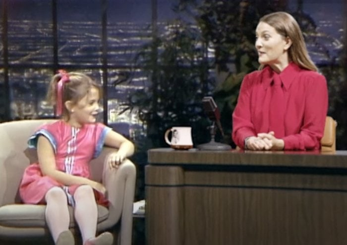 Drew Barrymore interviews her 7-year-old self in an adorable promo for her daytime talk show