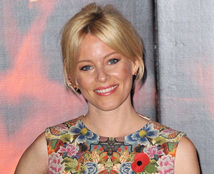 Elizabeth Banks styles her hair into an updo for her red carpet appearance