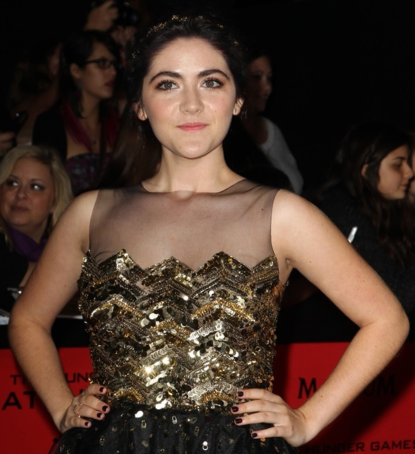 """Isabelle Fuhrman wears a gold sequined dress from Christian Siriano for the premiere of """"The Hunger Games: Catching Fire"""""""