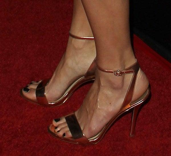 "Jaimie Alexander wears a pair of ""Catania"" sandals on her feet"