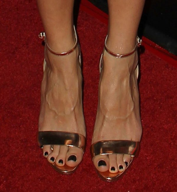 Jaimie Alexander's feet in metallic leather B Brian Atwood sandals