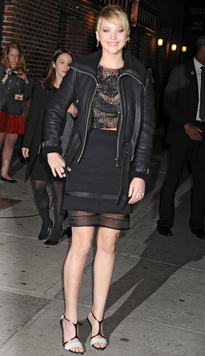 Jennifer Lawrence getting racy in a lace cropped top and a mesh-detailed skirt