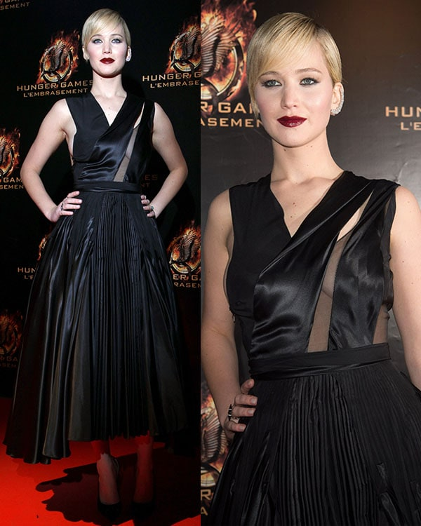 Jennifer Lawrence turned heads in a black Dior dress with a diagonal sheer panel that highlighted her cleavage