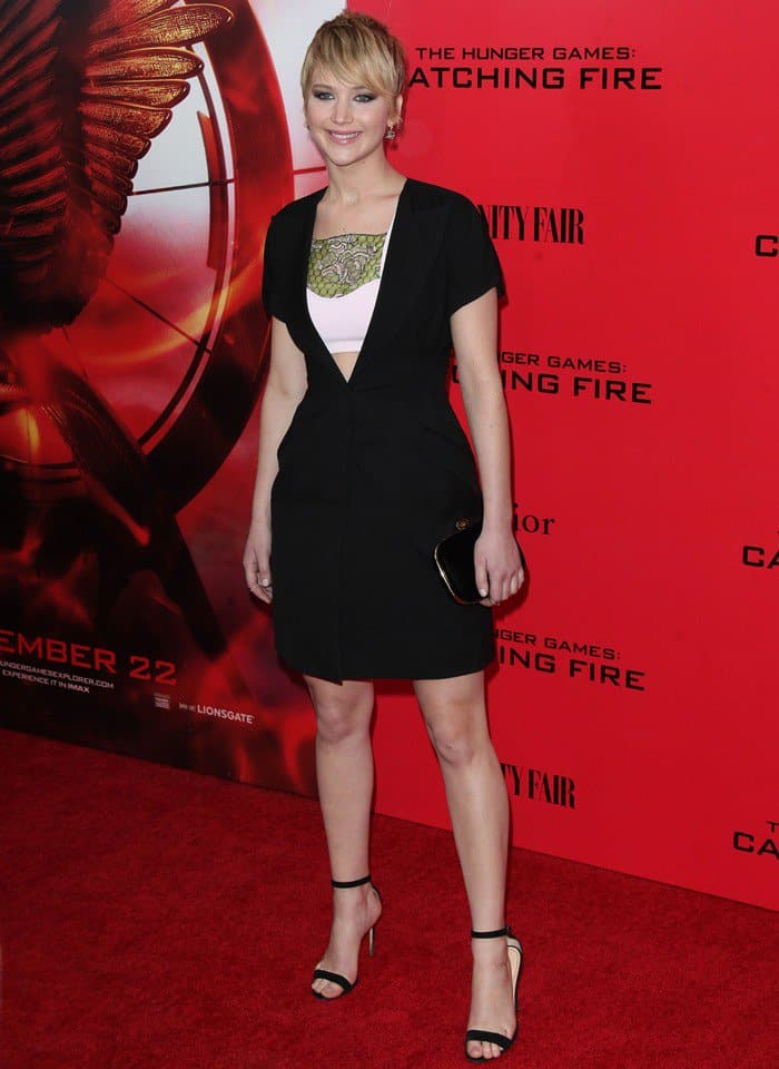 Jennifer Lawrence flaunts her slender legs in a Christian Dior dress and Manolo Blahnik sandals
