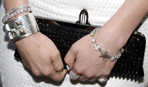 Jennifer Lopez toting a 'Miss Loubi' patent leather studded clutch