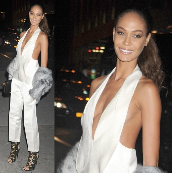 Joan Smalls wearing an Alexander Wang tuxedo halter jumpsuit paired with Swarovski Crystal–embellished lace-up sandals by Giuseppe Zanotti