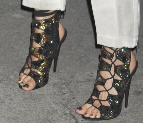 Joan Smalls wearing Swarovski crystal–embellished lace-up sandals by Giuseppe Zanotti