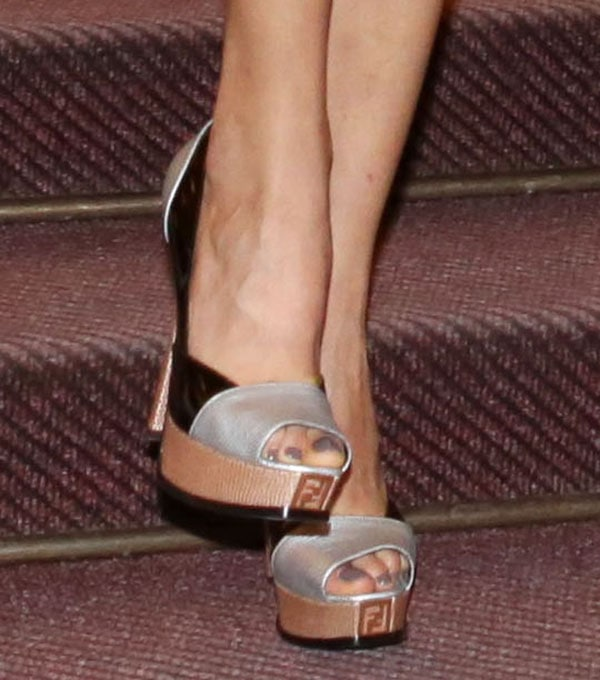 The heels come in a tri-tone design featuring a combination of black patent, textured silver, and textured bronze