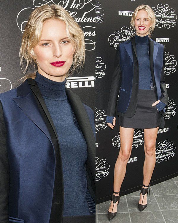 Karolina Kurkova sported a navy turtle-neck top and a black-and-navy blazer, all from the Salvatore Ferragamo Fall 2013 Collection