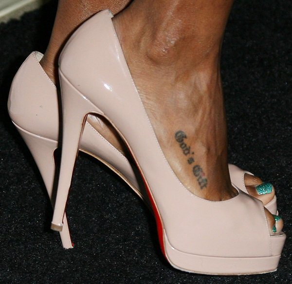 Kelly Rowland has a foot tattoo that reads God's Gift