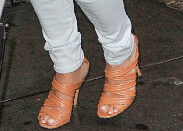Kim Kardashian's feet in beige ankle-strap sandals by Gianvito Rossi