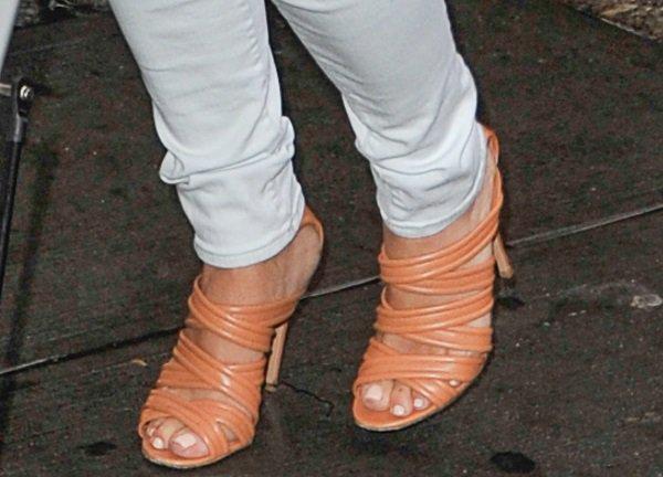Kim Kardashian's feet inbeige ankle-strap sandals by Gianvito Rossi