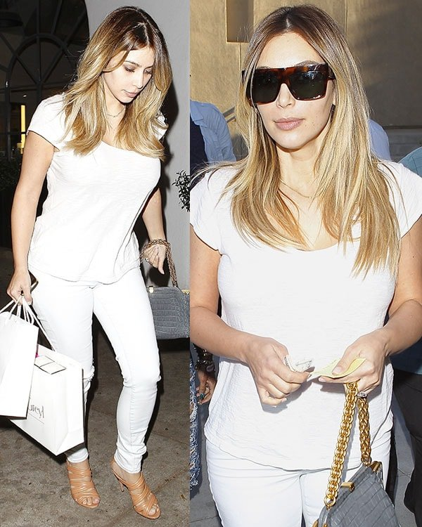 Kim Kardashian ina plain white tee paired with a pair of white ripped jeans