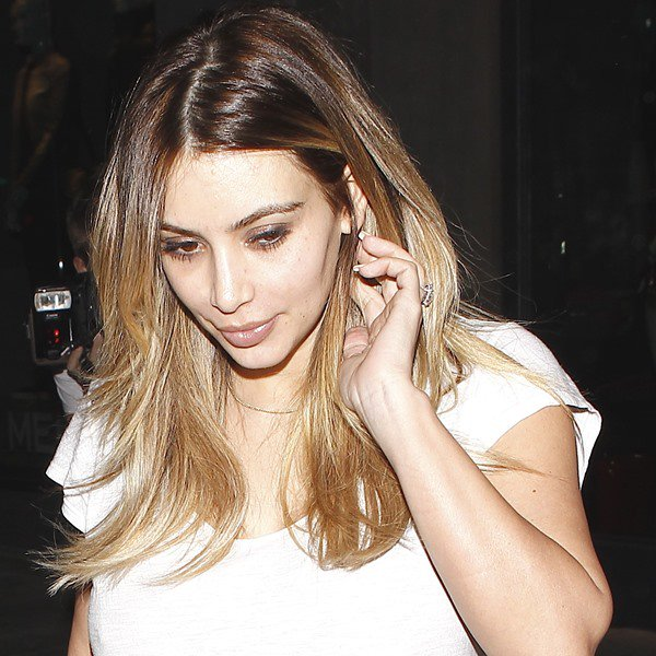 Kim Kardashian was almost completely makeup-free, but sported nude lipstick for a hint of sexiness