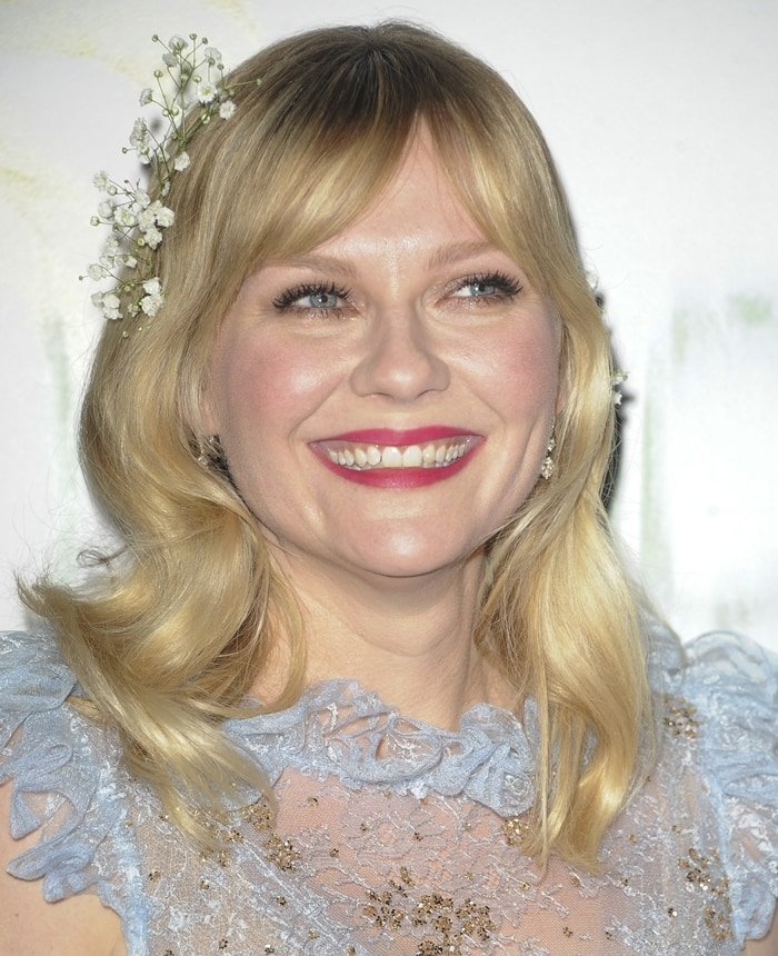 Kirsten Dunst smiles at the Los Angeles premiere of her new movie Woodshock