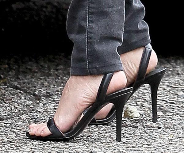"Kourtney Kardashian wearing Alexander Wang ""Antonia"" sandals"