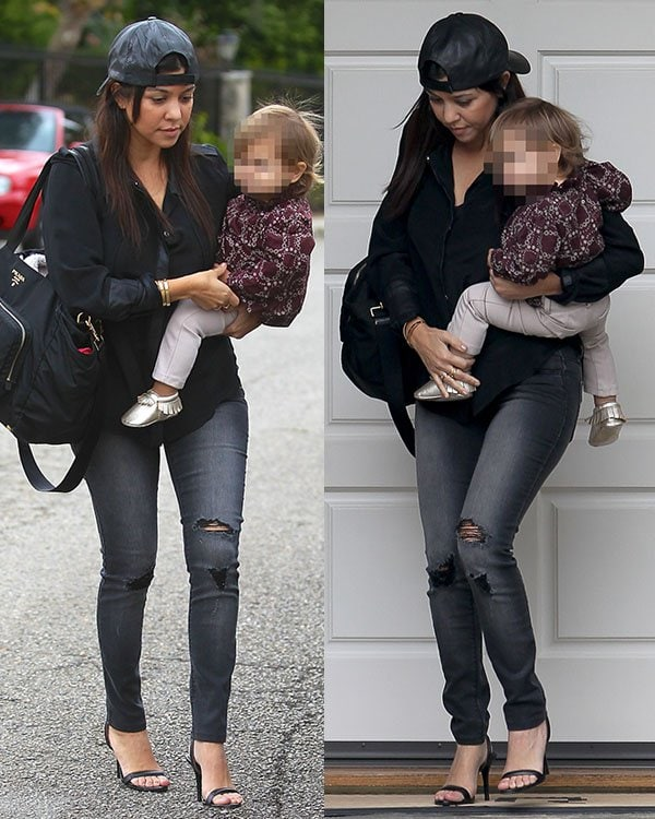 Kourtney Kardashian looking rather boyish in a very laid-back ensemble when she brought her daughter, Penelope, to a baby class in Beverly Hills recently