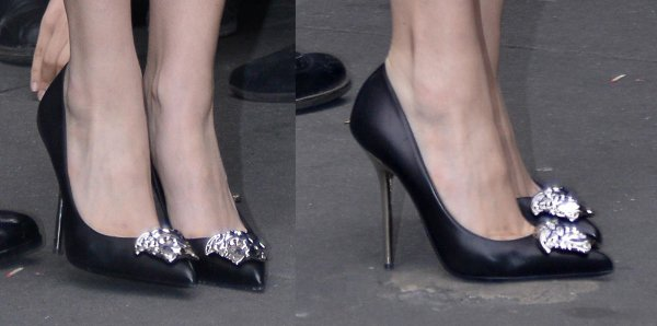 Lady Gaga wore black bejeweled pumps with a silver stiletto heel and a pointy toe