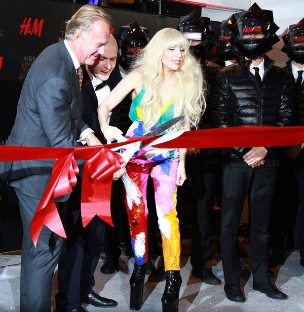 Lady Gaga cuts the ribbon to open the new H&M store while wearing a Kerin Rose Gold jumpsuit