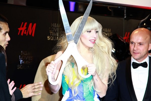 Lady Gaga holds a giant pair of scissors for the opening of the new H&M store in Times Square