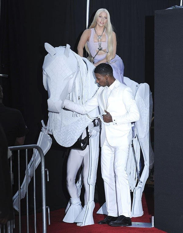 Lady Gaga arrived on a human-powered Trojan horse reminiscent of Bianca Jagger