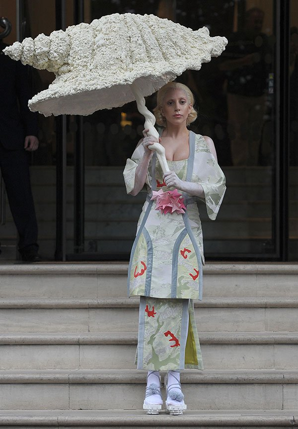 Lady Gaga opted for a Geisha look and sported a kimono-style dress while carrying a huge seashell parasol
