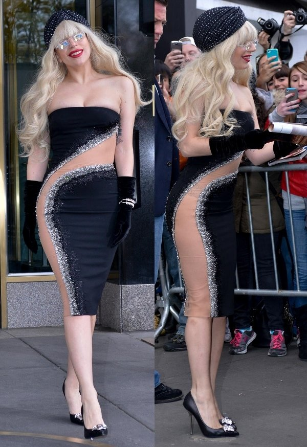 Lady Gaga was dressed in a black Atelier Versace dress that featured a sheer panel with silver crystal embellishments that curved round her body