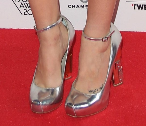 Laura Whitmore's writing foot tattoo says An t-Ádh, which is Irish for luck