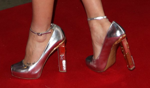 Laura Whitmore shows off her foot tattoo in metallic pumps