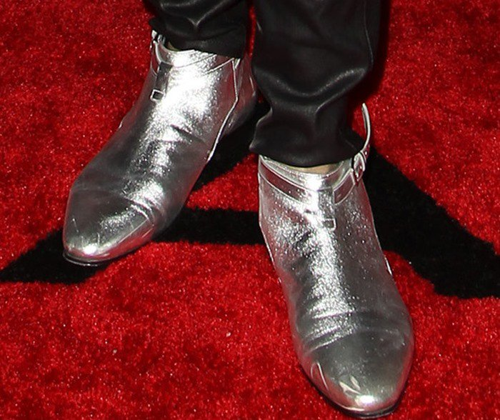 Lenny Kravitz finishes his red carpet ensemble with a pair of silver Saint Laurent boots on his feet