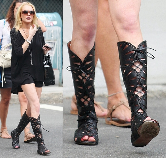 Lindsay Lohan wearing a little black dress and knee-high Azzedine Alaia lace-up gladiator strappy boots, visits Ina in SoHo on August 19, 2009