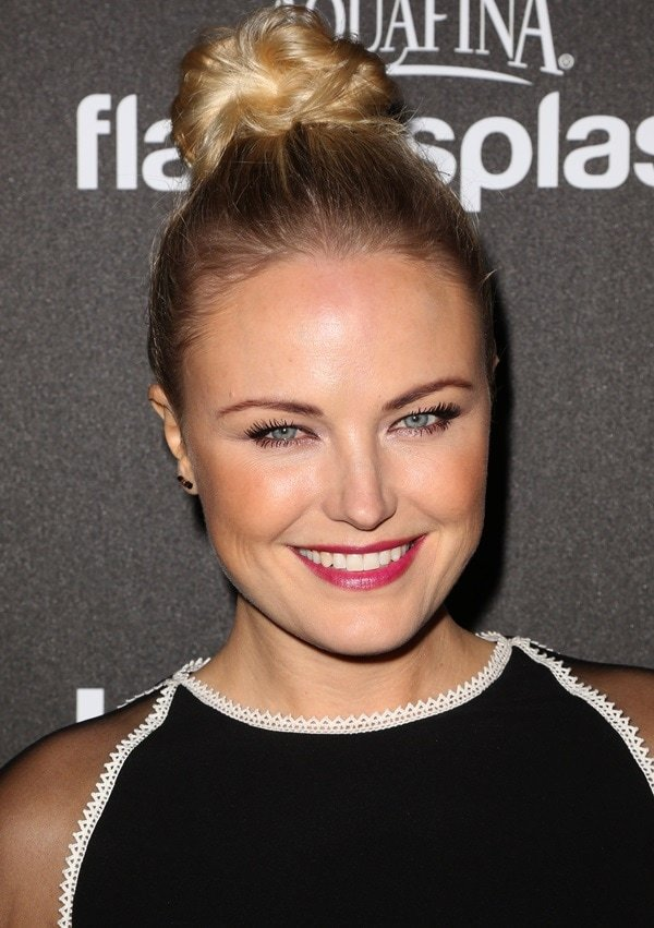 Malin Akerman's magenta lip and chic top-knot hairstyle