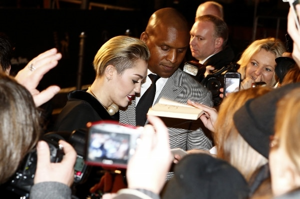 Miley Cyrus signs autographs for her fans at the 2013 Bambi Awards