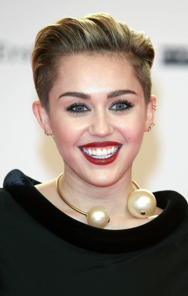 Miley Cyrus' dress featuring a velvet neckline