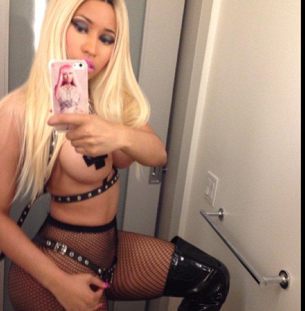 Nicki Minaj exposed her breasts in a Halloween cop costume