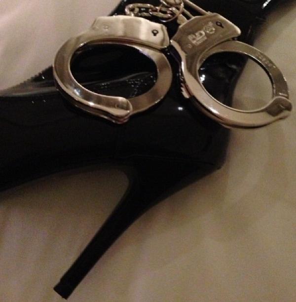 Nicki Minaj's over-the-knee boots and handcuffs