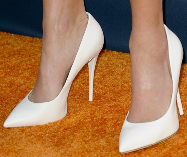 Nikki Reed wears a pair of white Giuseppe Zanotti pumps on her feet