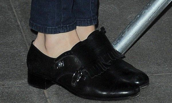 Pixie Lott's black low-heeled loafers