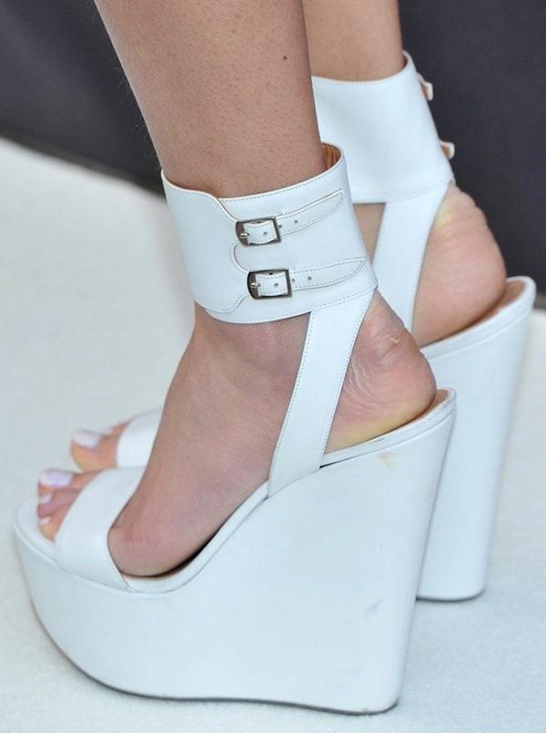 Pixie Lott's white ankle strap platform shoes