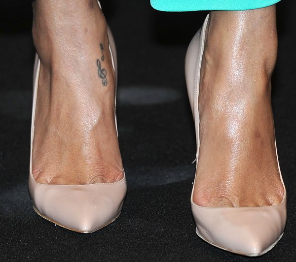Rihanna originally had music notes tattoos on her right foot