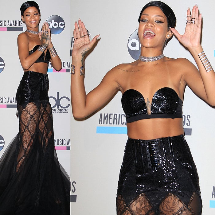Rihanna goofs around on the red carpet at the AMAs in a Jean Paul Gaulthier dress